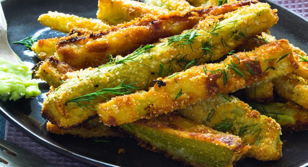 Bastoncini di zucchine al forno croccanti, un contorno gustoso e super dietetico. Solo 90 Kcal!